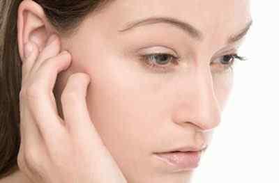 Почему болит голова за ушами